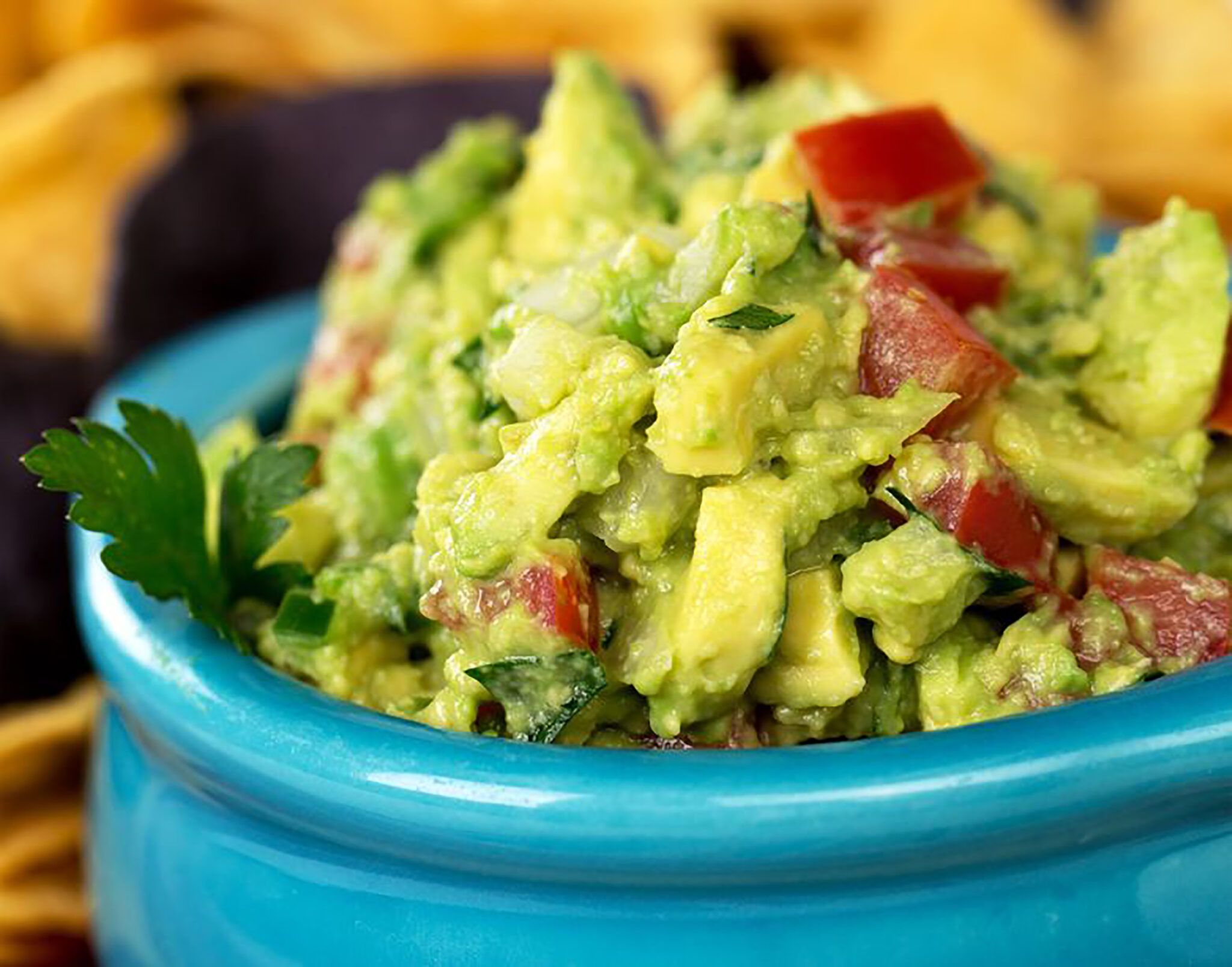 19625081 - a bowl of fresh guacamole with corn tortilla chips  intentional shallow depth of field