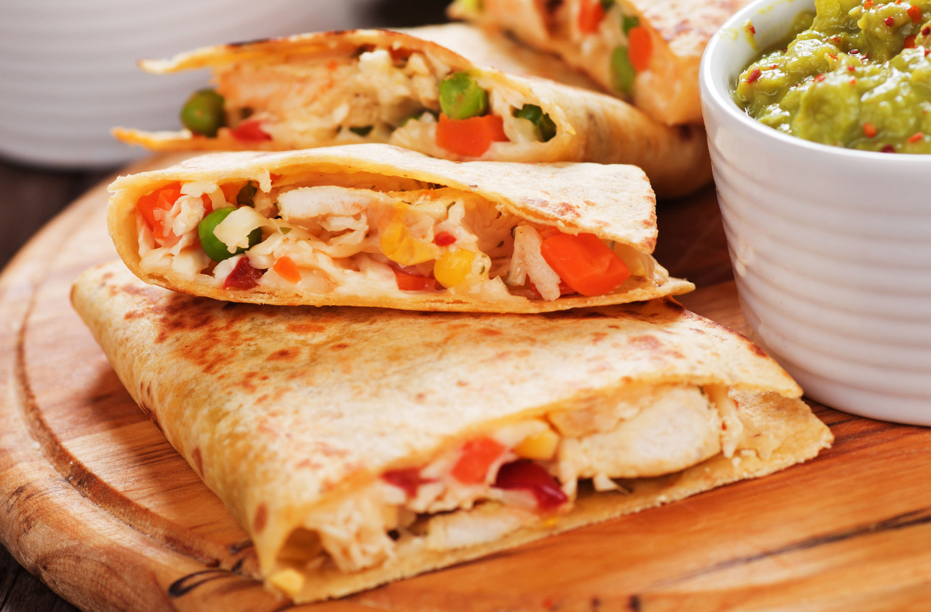 Mexican quesadillas with chicken meat, cheese and vegetables