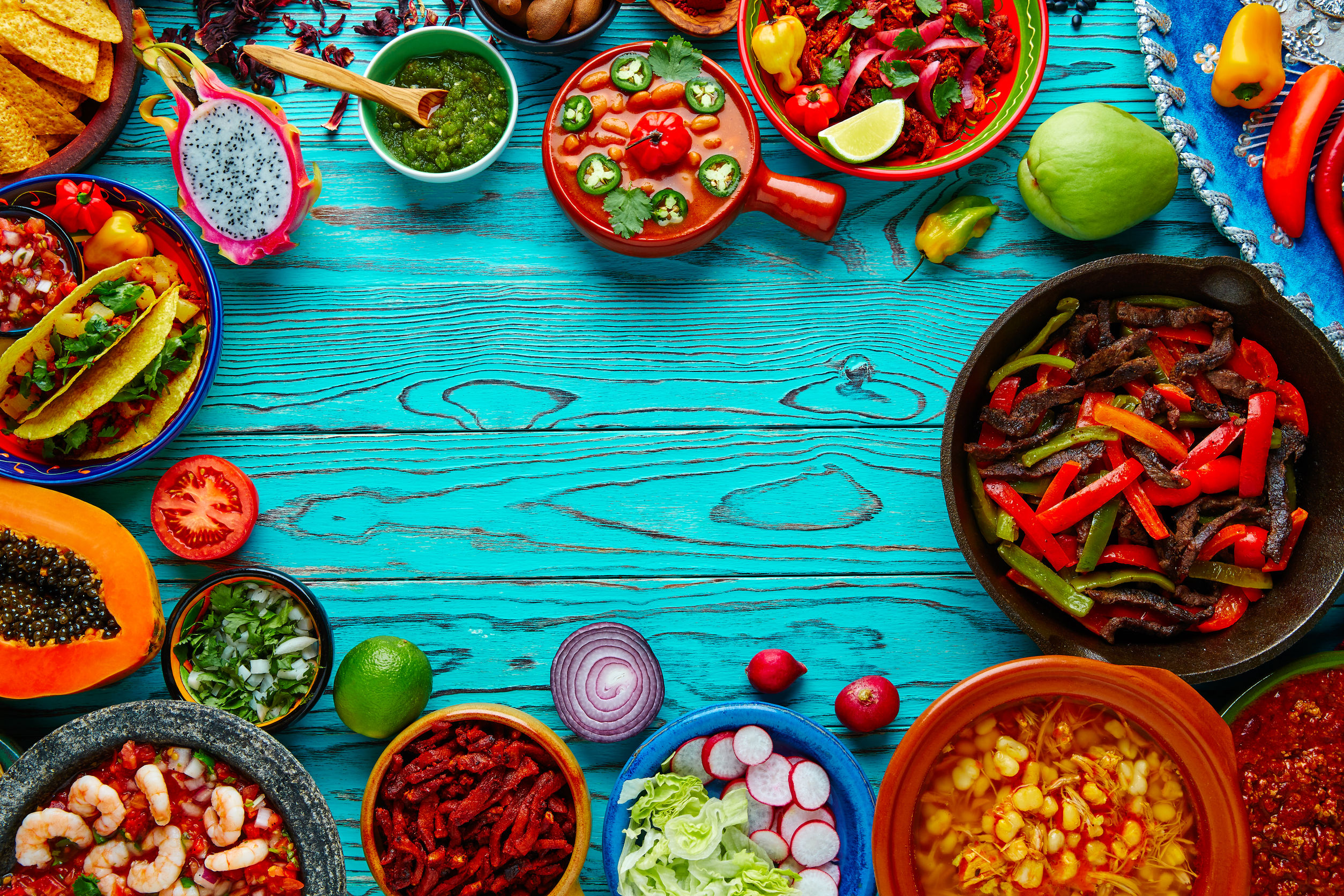 51858278 - mexican food mix copyspace frame colorful background mexico